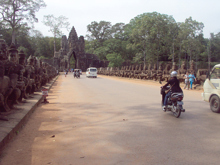 The bridge to the south gate of Angkor Thom.