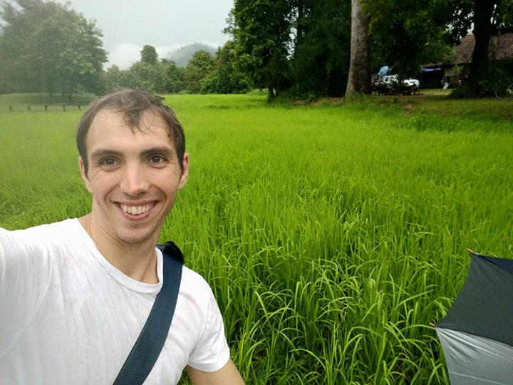 Isaac in a rice field.